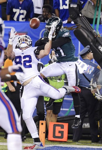 (AP Photo/Bill Kostroun). Philadelphia Eagles cornerback Ronald Darby (21) defends against New York Giants tight end Scott Simonson (82) during the first half of an NFL football game Thursday, Oct. 11, 2018, in East Rutherford, N.J.