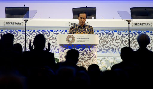 (AP Photo/Firdia Lisnawati). Indonesia's President Joko Widodo delivers his speech during the opening of International Monetary Fund (IMF) World Bank annual meetings in Bali, Indonesia on Friday, Oct. 12, 2018.