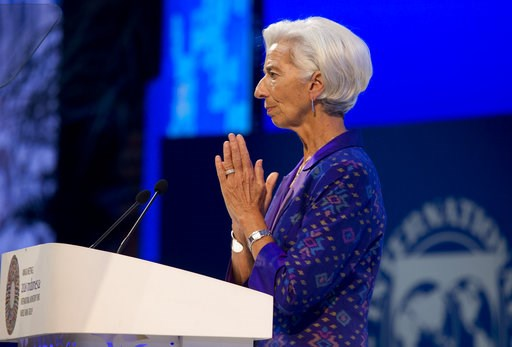 (AP Photo/Firdia Lisnawati). Managing Director of International Monetary Fund (IMF) Christine Lagarde delivers her speech during the opening of International Monetary Fund (IMF) World Bank annual meetings in Bali, Indonesia on Friday, Oct. 12, 2018.