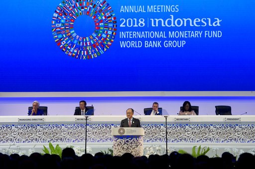 (AP Photo/Firdia Lisnawati). World Bank President Jim Yong Kim, foreground, delivers his speech during the opening of International Monetary Fund (IMF) World Bank annual meetings in Bali, Indonesia on Friday, Oct. 12, 2018.