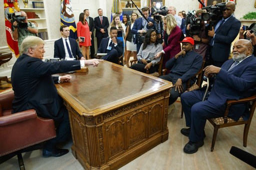 (AP Photo/Evan Vucci). President Donald Trump meets with rapper Kanye West and former football player Jim Brown in the Oval Office of the White House, Thursday, Oct. 11, 2018, in Washington.