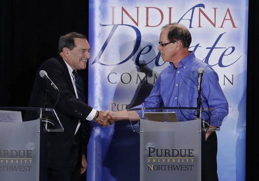 (AP Photo/Darron Cummings, Pool, File). FILE - In this Oct. 8, 2018, file photo, Sen. Joe Donnelly, D-Ind., left, shakes hands with Republican former state Rep. Mike Braun following a U.S. Senate Debate in Westville, Ind. Donnelly is hoping a visit fro...