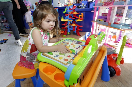 (AP Photo/Richard Drew). In this Aug. 30, 2018, photo Seraphina, 3, plays with a V-Tech Explore and Write Activity Set at the Walmart Toy Shop event in New York. Walmart says 30 percent of its holiday toy assortment will be new. It will also offer 40 p...