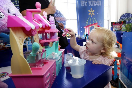 (AP Photo/Richard Drew). In this Aug. 30, 2018, photo 20-month-old Eva plays with Num Nom Silly Shakers Maker toy at the Walmart Toy Shop event in New York. Walmart says 30 percent of its holiday toy assortment will be new. It will also offer 40 percen...