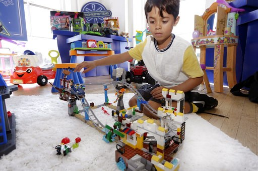 (AP Photo/Richard Drew). In this Aug. 30, 2018, photo Enzo plays with the Lego Creator Pirate Roller Coaster at the Walmart Toy Shop event in New York. Walmart says 30 percent of its holiday toy assortment will be new. It will also offer 40 percent mor...
