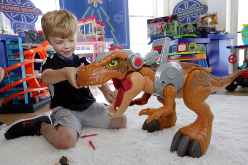 (AP Photo/Richard Drew). In this Aug. 30, 2018, photo Alexander, 5, explores a Jurassic World Jurassic Rex at the Walmart Toy Shop event in New York. Walmart says 30 percent of its holiday toy assortment will be new. It will also offer 40 percent more ...