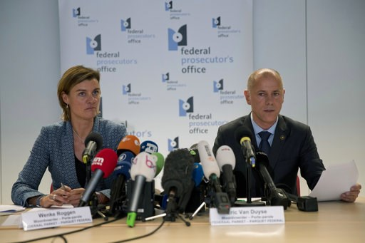 (AP Photo/Francisco Seco). Federal Prosecutor Spokespersons Wenke Roggen, left, and Eric Van Duyse read a press release at the Belgium Federal Prosecutor Office in Brussels, Thursday, Oct. 11, 2018. Belgian authorities charged five people Thursday in r...