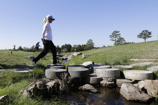 (AP Photo/Lee Jin-man). Danielle Kang of the United States walks on the second hole during the second round of the LPGA KEB Hana Bank Championship at Sky72 Golf Club in Incheon, South Korea, Friday, Oct. 12, 2018.