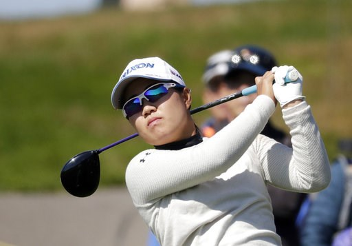 (AP Photo/Lee Jin-man). Nasa Hataoka of Japan watches her shot on the 7th hole during the second round of the LPGA KEB Hana Bank Championship at Sky72 Golf Club in Incheon, South Korea, Friday, Oct. 12, 2018.
