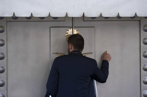 "(AP Photo/Petros Giannakouris). A man knocks the entrance of the Saudi Arabia's consulate in Istanbul, Friday, Oct. 12, 2018. A senior Turkish official says Turkey and Saudi Arabia will form a ""joint working group"" to look into the disappearance of Sau..."
