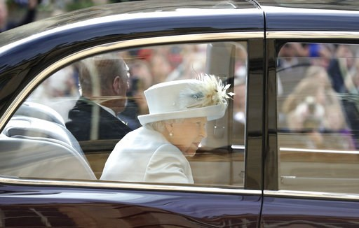 (Gareth Fuller/Pool via AP). Britain's Queen Elizabeth and Prince Philip arrive ahead of the wedding of Princess Eugenie of York and Jack Brooksbank at St George's Chapel, Windsor Castle, near London, England, Friday Oct. 12, 2018.