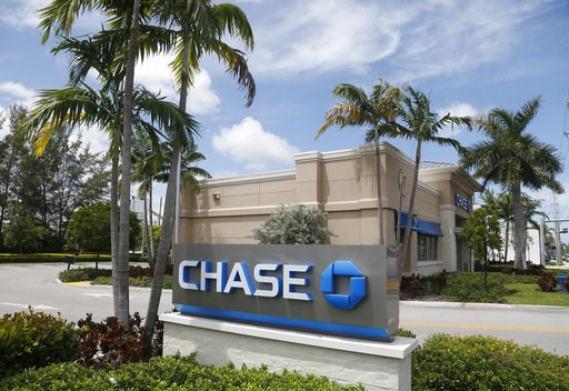 (AP Photo/Wilfredo Lee, File). FILE - This Aug. 17, 2016, file photo, shows a Chase bank branch in North Miami Beach, Fla. JPMorgan Chase & Co. reports earnings Friday, Oct. 12, 2018.