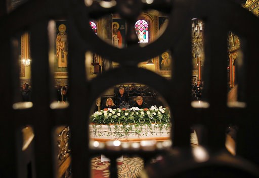 (AP Photo/Vadim Ghirda). Relatives sit near the coffin of television journalist Viktoria Marinova during a religious service prior to her funeral in Ruse, Bulgaria, Friday, Oct. 12, 2018. Marinova's body was found last Saturday near the Danube River in...