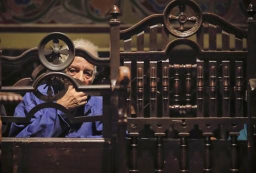 (AP Photo/Vadim Ghirda). An elderly man attends a religious service for slain television journalist Viktoria Marinova prior to her funeral in Ruse, Bulgaria, Friday, Oct. 12, 2018. Marinova's body was found last Saturday near the Danube River in the no...