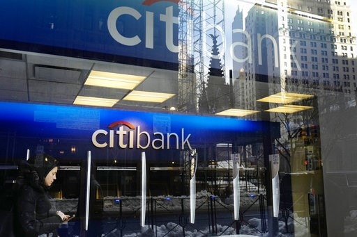 (AP Photo/Mark Lennihan, File). FILE - In this March 16, 2017, file photo, a customer enters a Citibank branch, in New York. Citigroup reports earnings Friday, Oct. 12, 2018.