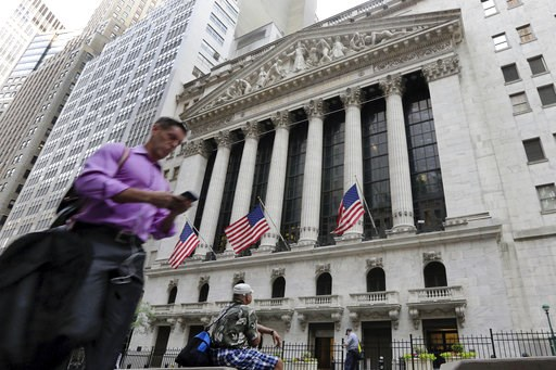 (AP Photo/Richard Drew, File). FILE - In this June 24, 2016, file photo, a man walks by the New York Stock Exchange. The U.S. stock market opens at 9:30 a.m. EDT on Friday, Oct. 12, 2018.