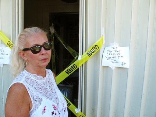 (AP Photo/Russ Bynum). Judi Stokowski stands outside her flooded gift shop, Thursday, Oct. 11, 2018, in Apalachicola, Fla., where some businesses flooded but the Gulf Coast city's historic homes were largely spared by Hurricane Michael. Waterfront home...