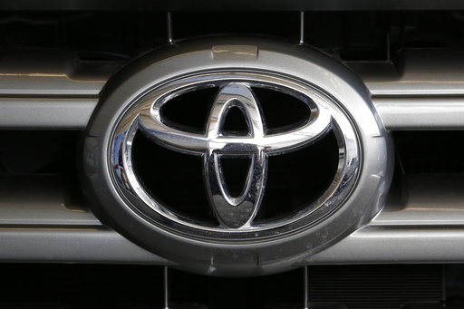 (AP Photo/Gene J. Puskar, File). FILE- This Feb. 11, 2016, file photo shows a Toyota logo on the hood of a 2016 Toyota Sequoia on display at the Pittsburgh International Auto Show in Pittsburgh. Toyota is recalling nearly 188,000 pickup trucks, SUVs an...