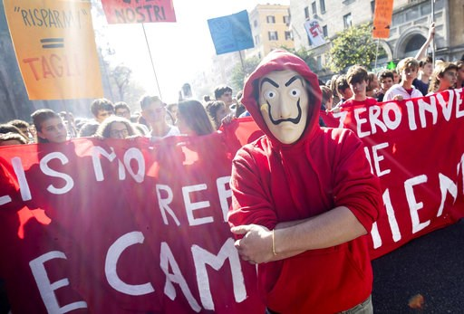(Massimo Percossi/ANSA via AP). Students march during a protest in Rome, Friday, Oct.12, 2018. Italian students across the country demonstrated against the failure of the government's spending plans to include promised allocations for schools, in the f...