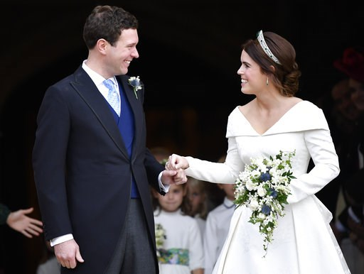 (Toby Melville, Pool via AP). Britain's Princess Eugenie and Jack Brooksbank leave St George's Chapel after their wedding at Windsor Castle, near London, England, Friday Oct. 12, 2018.