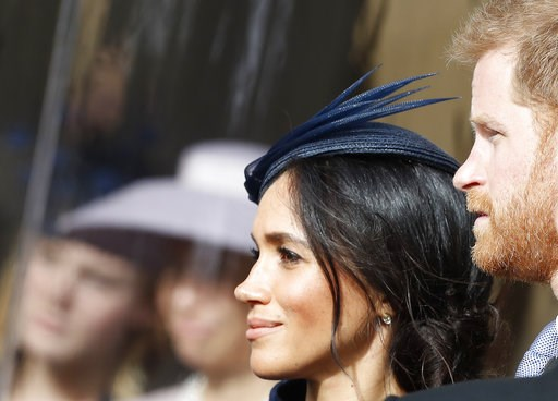 (AP Photo/Alastair Grant, Pool). Prince Harry and his wife Meghan, Duchess of Sussex, smile as they wait for the bridal procession at the wedding of Princess Eugenie of York and Jack Brooksbank in St George's Chapel, Windsor Castle, near London, Englan...