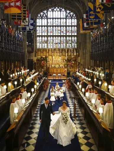 (Jonathan Brady, Pool via AP). Princess Eugenie of York and Jack Brooksbank after their wedding ceremony at St George's Chapel, Windsor Castle, near London, England, Friday Oct. 12, 2018.