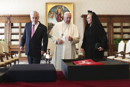 (Alessandro Bianchi/Pool Photo via AP). Pope Francis speaks as he meets with Chile's President Sebastian Pinera and his wife Cecilia Morel during a private audience at the Vatican, Saturday, Oct. 13, 2018.