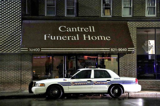 (Junfu Han/Detroit Free Press via AP). A Detroit Police vehicle is parked outside the Cantrell Funeral Home in Detroit on Friday, Oct. 12, 2018. Police said an anonymously written letter led inspectors to find the decomposed remains of 11 infants hidde...