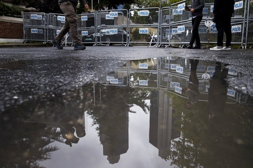 (AP Photo/Petros Giannakouris). Journalist walk past metal barriers at the entrance of Saudi Arabia's consulate in Istanbul, Saturday, Oct. 13, 2018.  Turkish officials have an audio recording of the alleged killing of journalist Jamal Khashoggi from t...