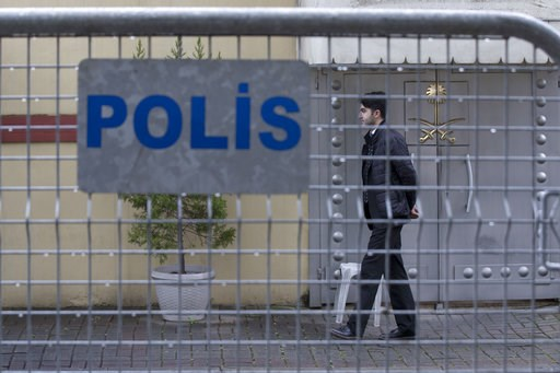 (AP Photo/Petros Giannakouris). A security personnel walks past the entrance of Saudi Arabia's consulate in Istanbul, Saturday, Oct. 13, 2018. Turkish officials have an audio recording of the alleged killing of journalist Jamal Khashoggi from the Apple...