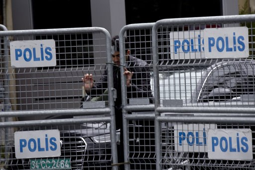 (AP Photo/Petros Giannakouris). A security personnel places metal barriers at the entrance of Saudi Arabia's consulate in Istanbul, Saturday, Oct. 13, 2018. Turkish officials have an audio recording of the alleged killing of journalist Jamal Khashoggi ...