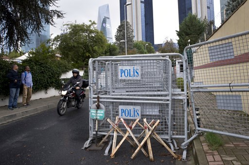 (AP Photo/Petros Giannakouris). Bystanders look at the Saudi Arabia's consulate in Istanbul, Saturday, Oct. 13, 2018. Turkish officials have an audio recording of the alleged killing of journalist Jamal Khashoggi from the Apple Watch he wore when he wa...