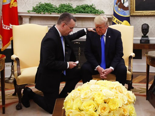 (AP Photo/Jacquelyn Martin). President Donald Trump prays with American pastor Andrew Brunson in the Oval Office of the White House, Saturday, Oct. 13, 2018, in Washington. Brunson returned to the U.S. around midday after he was freed Friday, from near...
