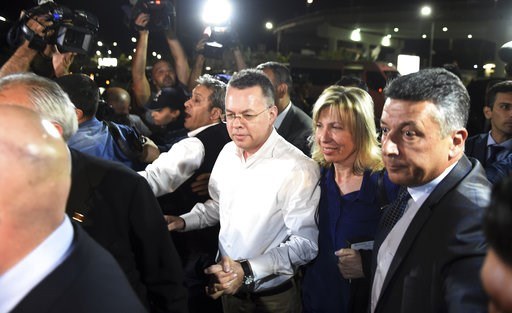 (AP Photo/Emre Tazegul). Pastor Andrew Brunson, center left, and his wife Norine Brunson arrive at Adnan Menderes airport for a flight to Germany after his release following his trial in Izmir, Turkey, Friday, Oct. 12, 2018, A Turkish court on Friday c...