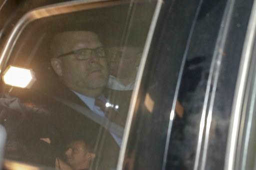 (AP Photo/Emrah Gurel). Pastor Andrew Brunson, rear, and U.S. Charge d'Affaires Jeffrey Hovenier sit inside a car as they head for the airport after his release following his trial in Izmir, Turkey, Friday, Oct. 12, 2018, A Turkish court on Friday conv...