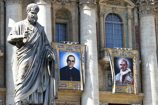 (AP Photo/Andrew Medichini). The tapestries of Roman Catholic Archbishop Oscar Romero, left, and Pope Paul VI hang from a balcony of the facade of St. Peter's Basilica at the Vatican, Saturday, Oct. 13, 2018. Pope Francis will canonize two of the most ...