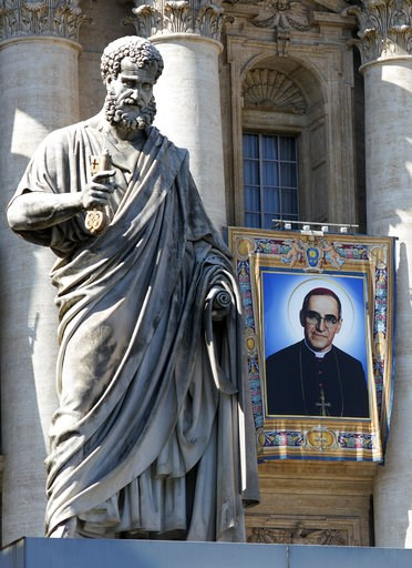 (AP Photo/Andrew Medichini). The tapestry of Roman Catholic Archbishop Oscar Romero hangs from a balcony of the facade of St. Peter's Basilica at the Vatican, Saturday, Oct. 13, 2018. Pope Francis will canonize two of the most important and contested f...