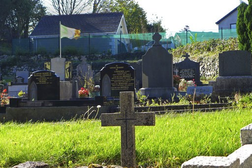 (AP Photo/Lorne Cook). In this photo taken on Wednesday, Oct. 10, 2018, an Irish flag flies over the graves in a cemetery in Carrickcarnan, Ireland, just next to the the Jonesborough Parish located in Northern Ireland. The land around the small town of...