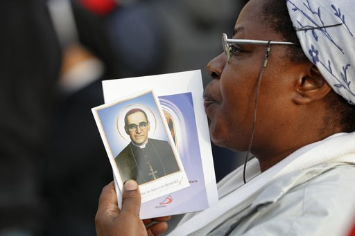 (AP Photo/Andrew Medichini). A woman holds a picture of martyred Salvadoran Archbishop Oscar Romero, in St. Peter's Square at the Vatican, Sunday, Oct. 14, 2018. Pope Francis canonizes two of the most important and contested figures of the 20th-century...