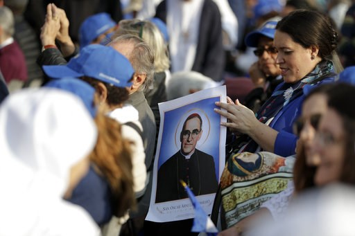 (AP Photo/Andrew Medichini). A woman holds a picture of martyred Salvadoran Archbishop Oscar Romero prior to a canonization ceremony in St. Peter's Square at the Vatican, Sunday, Oct. 14, 2018. Pope Francis canonizes two of the most important and conte...