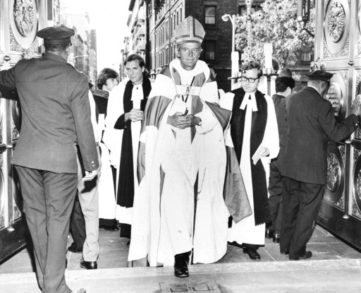 (AP Photo). FILE - In this Sept. 23, 1972 file photo, The Right Rev. Paul Moore Jr. arrives at the Cathedral of St. John the Divine in New York to be installed as the 13th Episcopal bishop of New York. The Episcopal Church is acknowledging the power of...