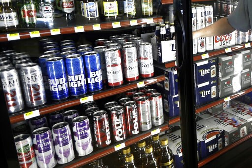 (AP Photo/Michael Conroy). FILE - This Wednesday, April 19, 2017 file photo shows the beer cooler behind the counter in a convenience store in Sheridan, Ind. In future sweltering years with a double whammy of heat and drought, losses of barley yield ca...