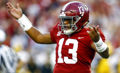 (AP Photo/Butch Dill). Alabama quarterback Tua Tagovailoa (13) gestures after throwing a touchdown pass during the first half against Missouri in an NCAA college football game Saturday, Oct. 13, 2018, in Tuscaloosa, Ala.