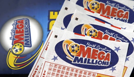 (AP Photo/Gerry Broome, File). FILE - This July 1, 2016, file photo shows Mega Millions lottery tickets on a counter at a Pilot travel center near Burlington, N.C. After nearly three months without a winner, the Mega Millions lottery game has climbed t...