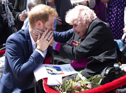 (Paul Edwards/Pool via AP). Britain's Prince Harry is embraced by 98-year-old Daphne Dunne during a walkabout outside the Opera House in Sydney, Australia, Tuesday, Oct. 16, 2018. Prince Harry and his wife Meghan are on a 16-day tour of Australia and t...