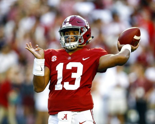 (AP Photo/Butch Dill). Alabama quarterback Tua Tagovailoa (13) throws a pass during the first half of the team's NCAA college football game against Missouri, Saturday, Oct. 13, 2018, in Tuscaloosa, Ala.