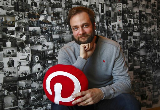 "(AP Photo/Ben Margot). In this Thursday, Oct. 11, 2018, photo Evan Sharp, Pinterest co-founder and chief product officer, poses for a photo in his office beside a wall of pinned photos he has taken at Pinterest headquarters in San Francisco. ""Social me..."