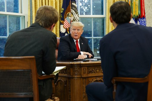 (AP Photo/Evan Vucci). President Donald Trump speaks during an interview with The Associated Press in the Oval Office of the White House, Tuesday, Oct. 16, 2018, in Washington.