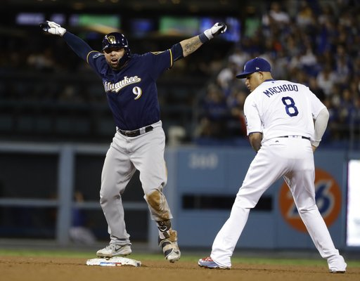 (AP Photo/Matt Slocum). Milwaukee Brewers' Manny Pina reacts after hitting a double during the seventh inning of Game 4 of the National League Championship Series baseball game against the Los Angeles Dodgers Tuesday, Oct. 16, 2018, in Los Angeles.