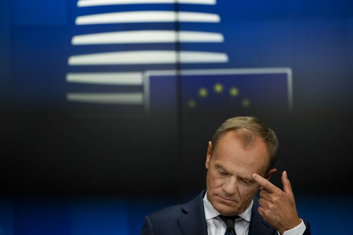 (AP Photo/Francisco Seco). European Council President Donald Tusk touches his eyebrow after delivering a statement during a joint news conference following a Tripartite Social Summit roundtable at the European Council headquarters in Brussels, Tuesday,...